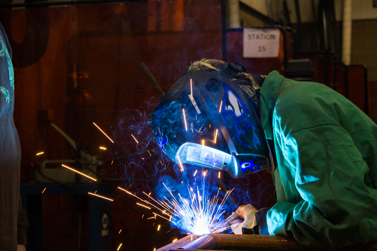 Photo of a student welding at the Century Career Center