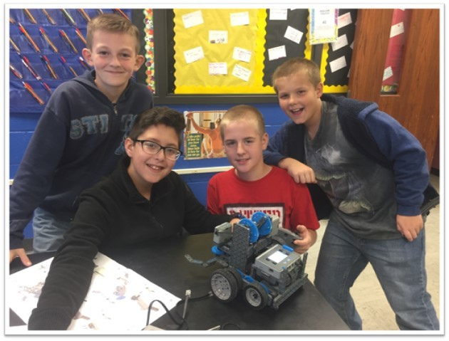 Columbia 6th grade students work on their robotics project